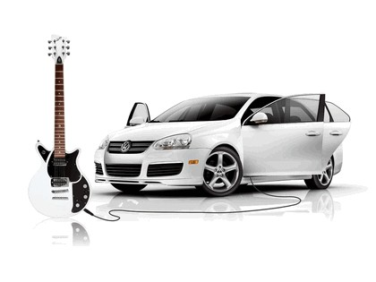 2006 Volkswagen Jetta with First Act Guitar 1